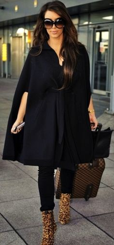 Kim Kardashian Louis Vuitton luggage Leopard print boots AND that black cape