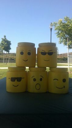 Lego party centerpieces. Made from?? Maybe Peanut butter jars?