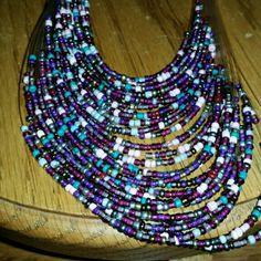 MULTICOLORED AND LAYERED NECKLACE WITH EARINGS Multicolored beads blues and purples Jewelry Necklaces