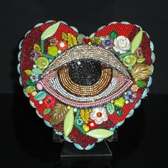mini sculpture by  Betsy Youngquist.  love her doll work and beading.