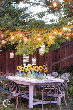 This divine backyard dining space is sparkling with original handcrafted Sonnenglas! A perfect setup for enjoying summer nights filled with sunflowers, sweet tea, and shimmering lights in the trees…
