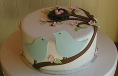 Maybe the cake in Baby Blue, and the birds in 2 different shades of darker blue with white flowers, blue speckled eggs