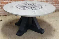 """compass rose, hand painted on 42"""" round dining table. Artisan hand crafted farm tables and reclaimed wood furniture from ecustomfinishes.com"""