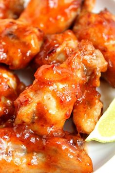 Sweet and Spicy Crock-Pot Chicken Wings Recipe - spicy chipotle peppers, honey, garlic and brown sugar are the perfect sweet and spicy combo! This easy game day appetizer is a must make this football season!