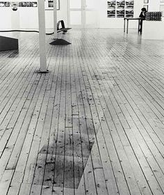 Victor Burgin Photopath 19679 installation view as part of 19561972  When Attitudes Became Form Kettles Yard Cambridge 1986. (via Frieze)  Photographs of the floor on which the work was to be installed in the exhibition context were enlarged to the extent that they exactly matched the scale of the floor itself. These photographs were then laid out directly on the floor of the exhibition room so that they covered the object that they simultaneously presented.  Daniel Marzona Conceptual Art