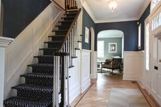 awesome stair runner, especially w/white wainscoting + navy walls @ Hillary T - reminds me of your house! Coastal Living Rooms, My Living Room, Wainscoting Styles, Black Wainscoting, Painted Wainscoting, Wainscoting Height, White Paneling, Painted Panelling, White Beadboard