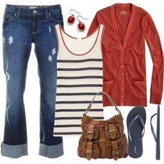 travel - cuffs on jeans down, larger earrings, white with blue stripe shirt and navy sweater.