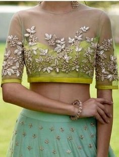 Heres the best new blouse styles - sexy blouse, traditional blouses, lehenga blouse and latest saree blouses to flaunt your best features for your body typeStunning sheer cocktail blouse with golden leaf motifsAnushree Reddy close up details. Golden Blouse Designs, Netted Blouse Designs, Fancy Blouse Designs, Blouse Neck Designs, Blouse Styles, Shirt Designs, Choli Designs, Lehenga Designs, Sari Bluse