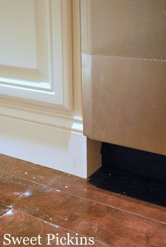 base trim on cabinets to make them look more custom