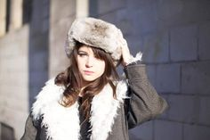 Ushanka Hat : Russian fur cap with ear flaps that can be tied up to the crown of the cap, or tied at the chin to protect the ears, jaw and lower chin from the cold (Karen FD1A1)