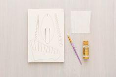 Use basic DIY supplies to update laser cut cardboard animal heads.