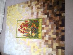 By Barb Stephenson of Kyle, Saskatchewan. Barb used a panel from the Edible Garden line by Stephanie Brandenburg, then batiks to piece the sun shining on her garden, surrounded by paving stones.