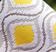 grey and yellow ikat wallpaper via calder clark designs blog