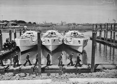 """SURRENDERED E-BOATS ARRIVE AT PORTSMOUTH. 22 JUNE 1945, HMS HORNET, PORTSMOUTH. 3 SURRENDERED GERMAN E-BOATS ARRIVED TO BE TAKEN OVER BY THE ROYAL NAVY AT HMS HORNET, LIGHT COASTAL FORCES BASE AT PORTSMOUTH. German crews leaving the 3 E-boats at HORNET. The crews will be taken back to Germany in due course. Pelman, L (Lt) © IWM (A 29323) """"Click on the image to enlarge it"""""""