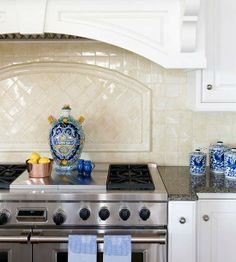 Texture and Shine  Buttercream-hue hand-glazed tiles lend warmth and country elegance to the backsplash in this French-style kitchen. Above the stove, a differing pattern adds texture and visual interest. To get a standout backsplash like this, choose tiles a few shades warmer than your cupboard paint.