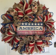 "Patriotic Rustic Burlap Wreath -July 4th Wreath -Summer Wreath -Red White Blue Wreath -Rustic Décor  Freshen up your entryway with a rustic burlap patriotic wreath using deco mesh decorated with premium patriotic ribbons, deco mesh tubing and wood sign, ""America Home of the Free & the Brave"".  This extra large wreath measures 28"" x 28"" x 9"" deep. Ready to Ship. Enjoy FREE Shipping."