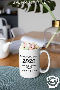 Wedding Mugs | Postponed Wedding Mug – 2020 The One Where It Got Postponed – Friends Quarantine Mug. Design printed using a sublimation process making the design part of the mug surface. Prints are high quality and won't scratch, peel or fade away over time. This mug printed on both front and back sides of the mug. 100% Dishwasher and Microwave safe. Collect this mug for the wedding event. #WeddingMugs #TrumpMugs #CeramicMugs #MugForMen #MugsForWomen #Mugs #impropermug