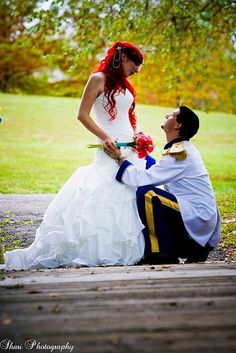 The Little Mermaid Wedding Theme! If a guy is willing to do this with you, then hold on to him forever sister! GAH!