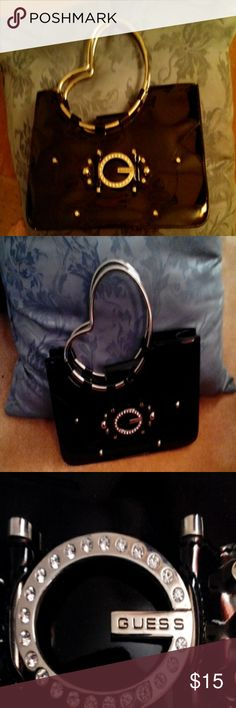 Cute guess night out purse Guess Black purse, just the right size for a night out, used but good condition, small white mark on back corner Guess Bags Clutches & Wristlets