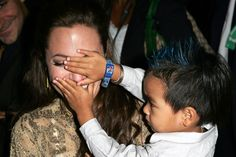 Playing peekaboo with son Maddox at the Shark Tale premiere in September 2004
