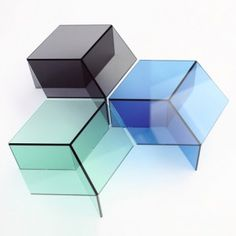 German designer Sebastian Scherer used sheets of coloured glass to create these tessellating tables. Isom tables consist of a hexagonal top resting on three upright pieces, and from certain angles look like an isometric drawing of a cube...just like our Chelsea design at the right angle!