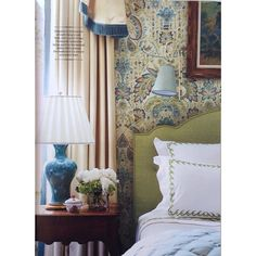 Paisley wallpaper in blue & green, lime green headboard & bedding, blue lamp, neutral drapes--I could sleep here.