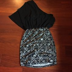 Beautiful Lace Mini Dress Worn very few times and in great condition. One sleeve dress sheer top with a silver and black lace skirt. Dresses One Shoulder