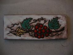 wall tile W.Germany Ruscha in classic form number 734. Figure bunch of grapes. Size 30 to 11 cm.