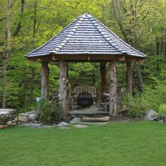 Natural Gazebo.  I like the rustic look.  Needs to be screened in and larger.