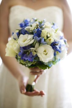 blue lakspur, bi-color hydrangea . roses wedding flower bouquet, bridal bouquet, wedding flowers, add pic source on comment and we will update it. www.myfloweraffair.com can create this beautiful wedding flower look.