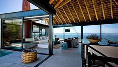 Silver Bay Holiday House by SAOTA Architects exposed timber beams structure roof