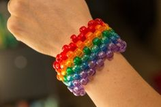 This is a guide about making a kandi cuff bracelet. Using the peyote beading stitch, you can create a custom patterned bracelet. Stretching string and and colorful plastic pony beads are all that's needed. Diy Kandi Bracelets, Beaded Cuff Bracelet, Beaded Bracelet Patterns, Friendship Bracelet Patterns, Tattoo Bracelet, Kandi Patterns, Stitch Patterns, Rainbow Choker, Kandi Cuff