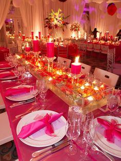 Love the floating flowers and candles and all the pink!