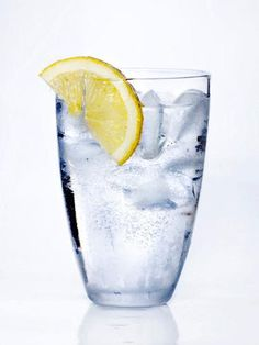 Sip an 8 oz. glass of water with half of a lemon squeezed into it. Water fights constipation and flushes excess bloat-inducing sodium out of your body, and lemon acts as a natural digestive aid and diuretic Health Tips, Health And Wellness, Women's Health, Getting Rid Of Bloating, Bloated Belly, Health Questions, Lemon Wedge, Lemon Water, Home Remedies