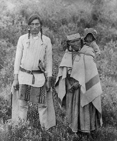 Assiniboine man with his wife and child - circa 1890