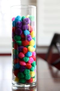 """On the Sunday before Easter, Introduce the """"Warm Fuzzies"""" jar. For each act of service the kids perform, they put a warm fuzzy in the jar. The goal is to fill the jar by Easter Sunday and, in the process, to serve each other and be more like Jesus. It is fun to catch the kids doing kind deeds for each other."""