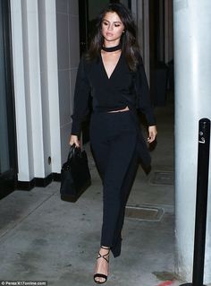 Selena Gomez turns heads in all-black as she hits Hollywood hotspot #dailymail