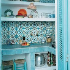 Light blue tiles & open shelving keep this kitchen fun and eclectic.