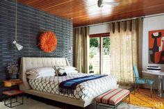 Sheer grommet hole draperies in a modern mid-century designed bedroom by Adler Doonan.