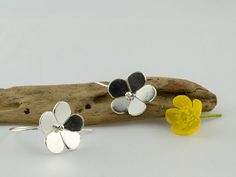 silver buttercup flower hoop earrings by LaPetiteMaisonBijoux, €22.50
