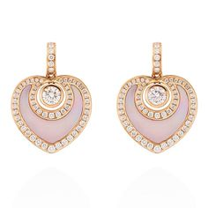 These abstract hearts are subtly decorated with diamonds in Boodles' rose gold and mother-of-pearl earrings. Perfect for a present in our gift inspiration on Mother's Day. http://www.thejewelleryeditor.com/gift-inspiration/mothers-day-ideas/products/ #jewelry