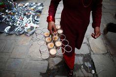 Kathmandu, Nepal: A woman carries tea to sell to street vendors Masala Tea, Tea Art, Chai, Nepal, Tea Time, Pride, Wisdom, Things To Sell, Woman