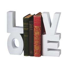 Love means never having to say you're sorry . . . for having a superior book collection! This pair of Lovely Bookends serves as a secure nesting spot for all your favorites. A charming double-sided set...  Find the Lovely Bookends, as seen in the Romantically Rustic Collection at http://dotandbo.com/collections/romantically-rustic?utm_source=pinterest&utm_medium=organic&db_sku=113029