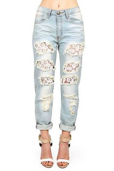 f088a91942d Mid-rise straight faded wash denim with traditional five pockets and zipper  and button fly