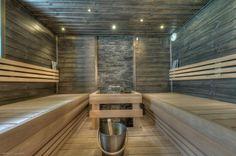 Sauna ja kiviseinää, kiva valaistus