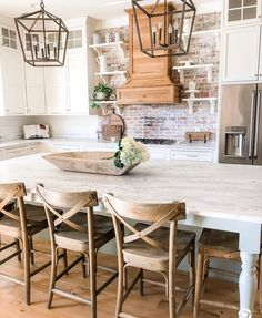 What I love: natural wood floors/chairs/table, white cabinets and counter, rectangle bowl on table What I don't love: light fixtures, brick wall with odd shelves , room is too big and impractical Farmhouse Kitchen Cabinets, Modern Farmhouse Kitchens, Kitchen Cabinet Design, Home Kitchens, Rustic Farmhouse, Farmhouse Style, Dream Kitchens, Kitchen Cabinetry, Small Kitchens