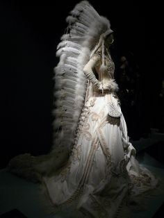 Wedding dress with feather headdress at Jean Paul Gaultier show at the DeYoung Museum by delight.1027, via Flickr Native American Wedding, Native American Fashion, Native American Indians, American Women, Jean Paul Gaultier, Crossover, Wedding Dress With Feathers, Feather Headdress, Indian Headpiece