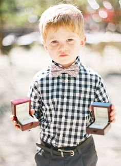 Don't want the traditional tux? Every ring bearer will look adorable in a bow tie and colorful shirt!