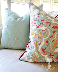 Fabulous color combination.  Love the orange and teal pillow! Good idea for master bedroom