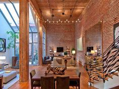 Exposed Brick and Timber Interiors Flooded By Light-the second view